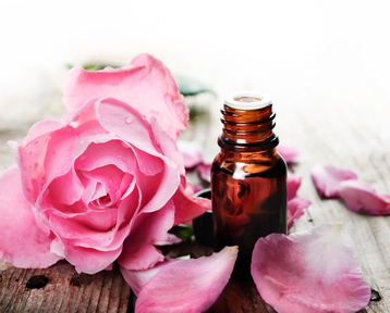 Young Living Essential Oils - roses and bottle